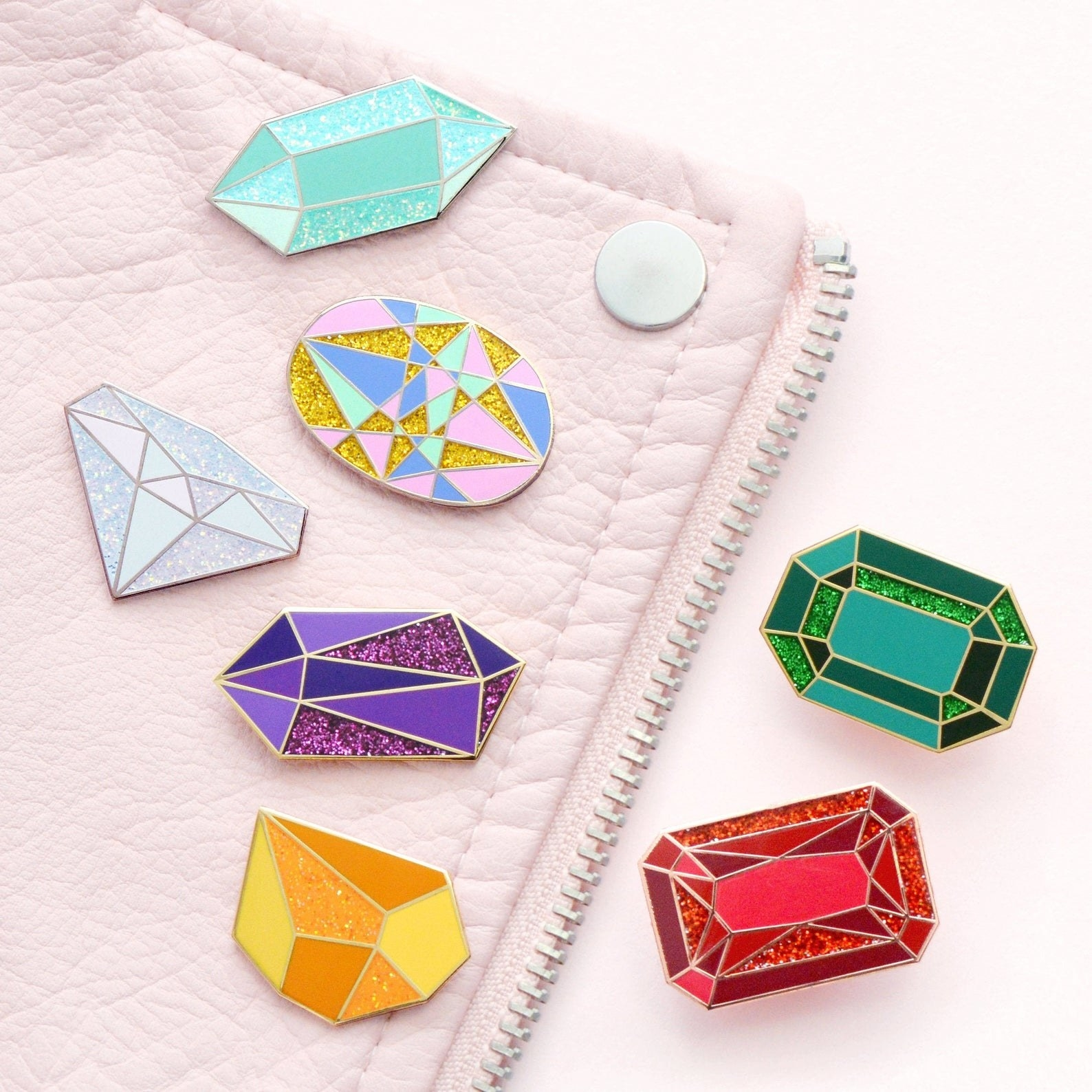 product shot of different pins shaped like gem stones