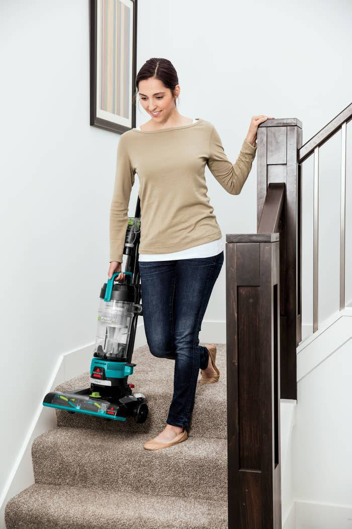 A model carrying the vacuum down a set of stairs