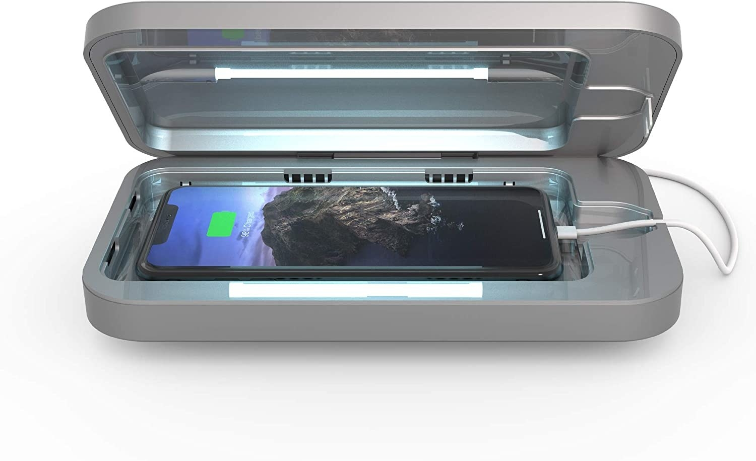 the phonesoap open with a phone neatly fitting into the cavity with a cord leading out of it to charge