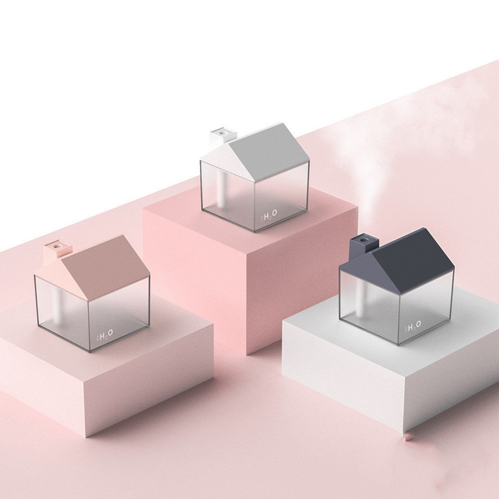 The pink, white, and blue oil diffusers which are house shaped