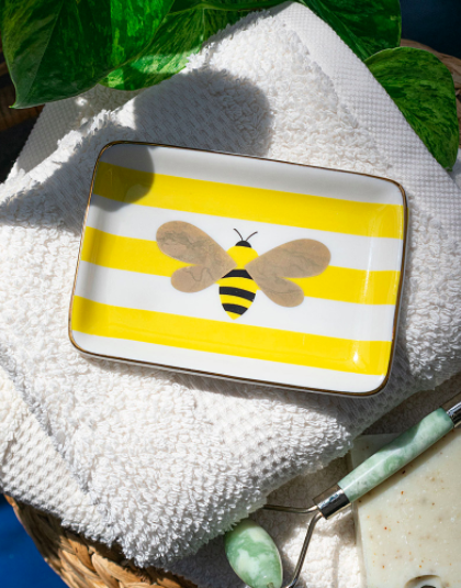 A flatlay of the tray with a graphic bee design on it