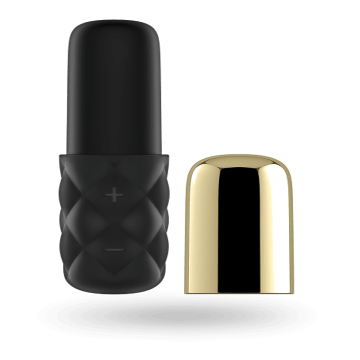 The mini vibrator with the metallic gold cap removed to reveal a plain black silicone top