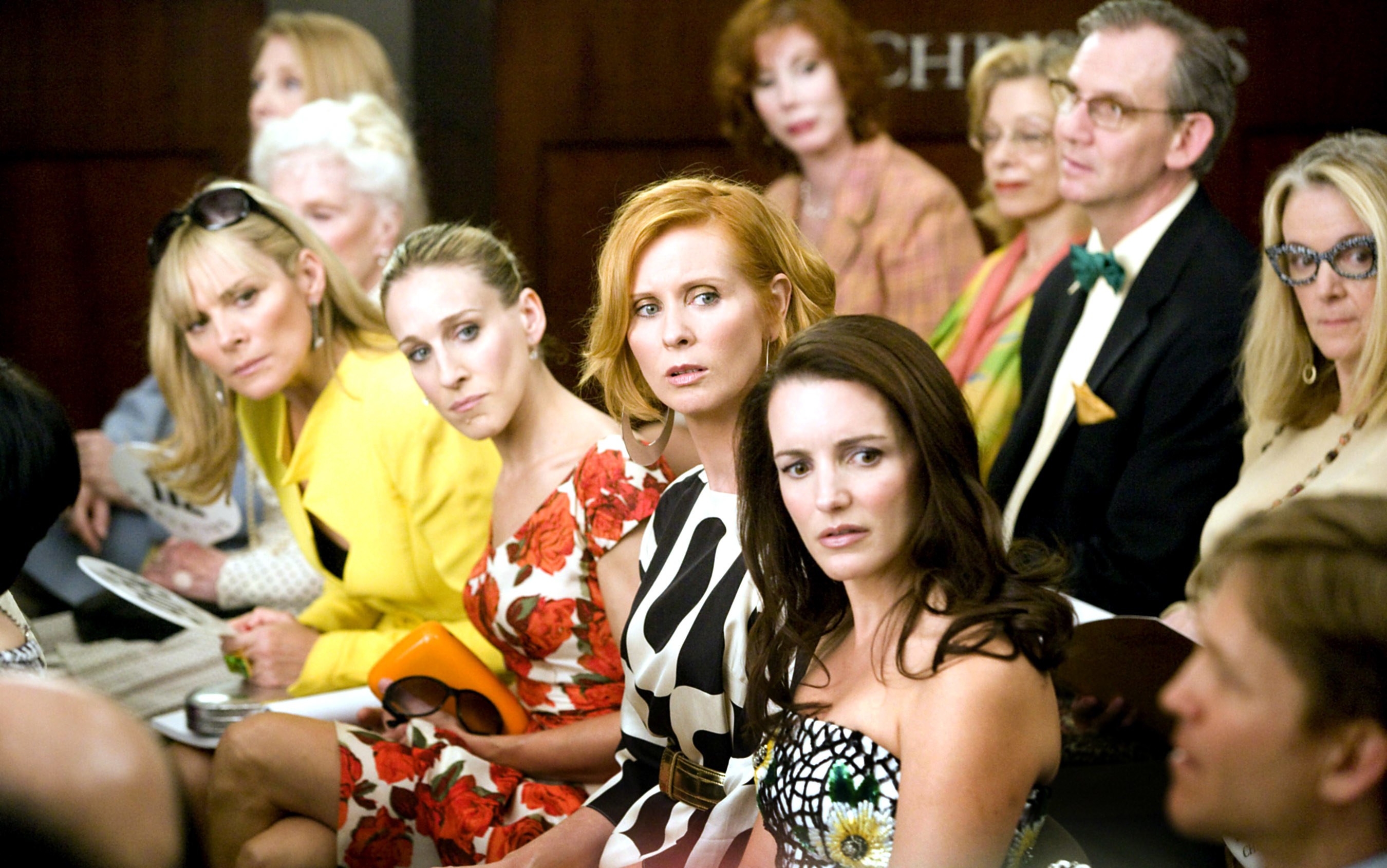 Samantha, Carrie, Miranda, and Charlotte at an auction