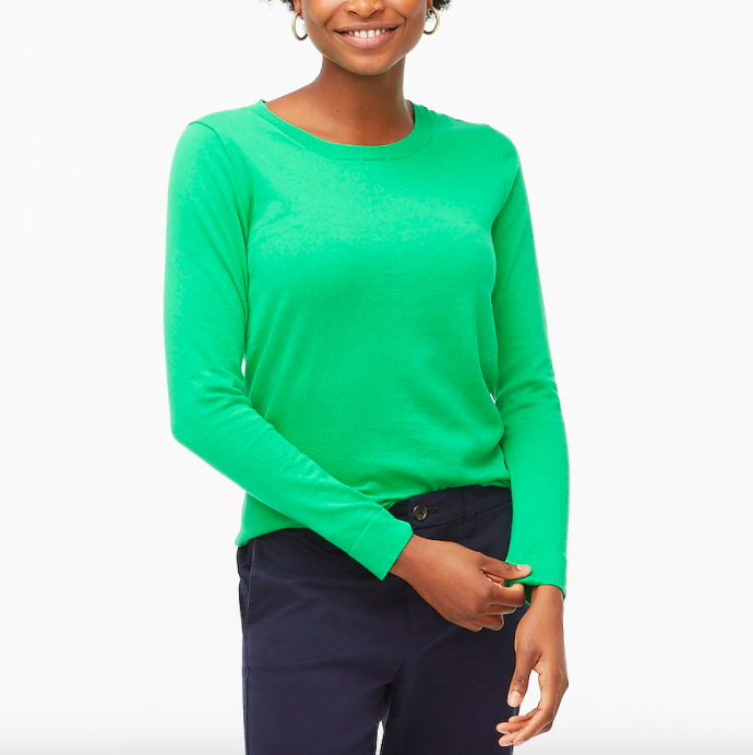 A model wearing the cotton sweater in green