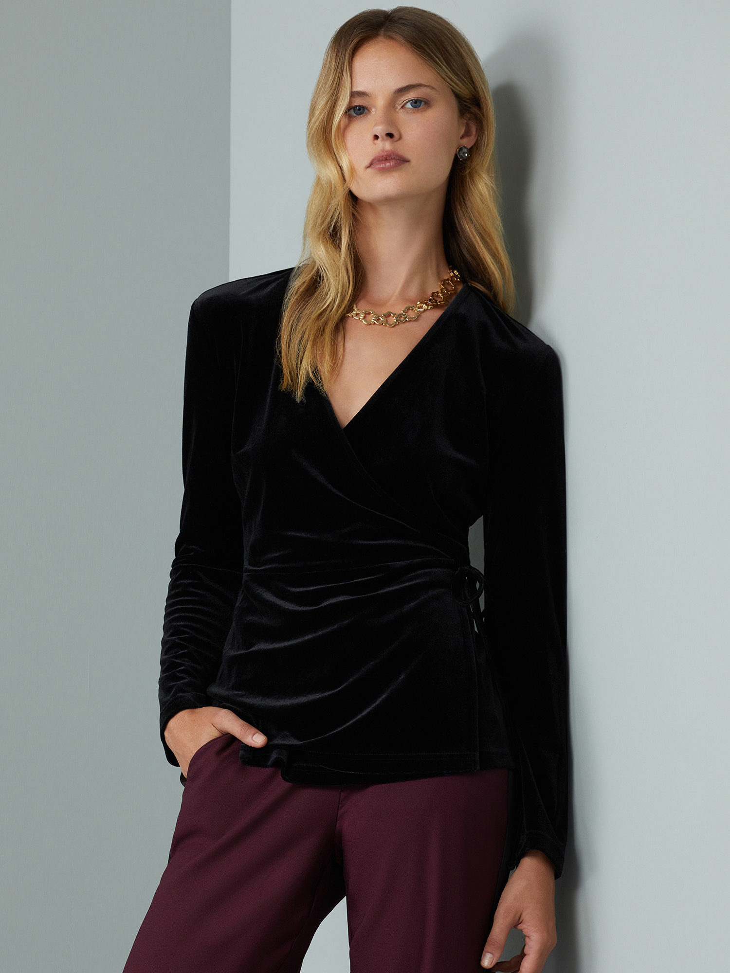 Model wearing a black velvet top