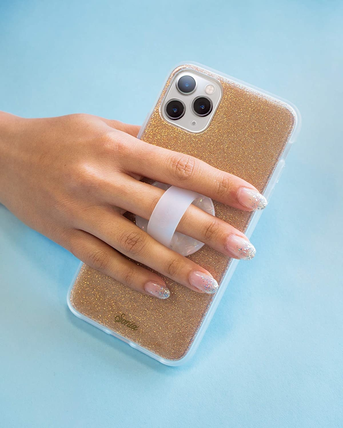 A person holding their phone using the phone ring