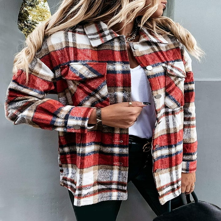 A model wearing the B Red plaid shirt