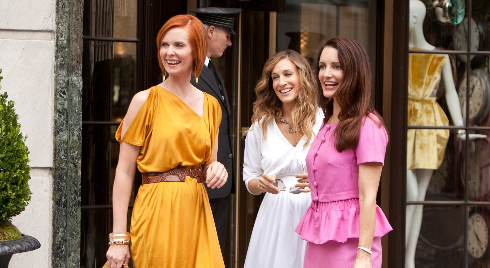 Miranda, Carrie, and Charlotte standing outside of a shop