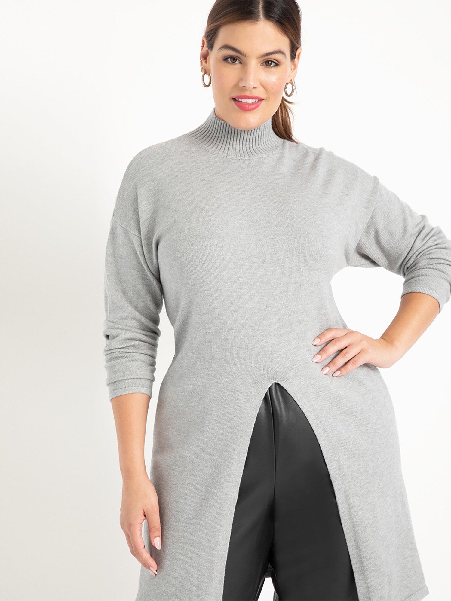 Model wearing grey mock neck tunic top with split front