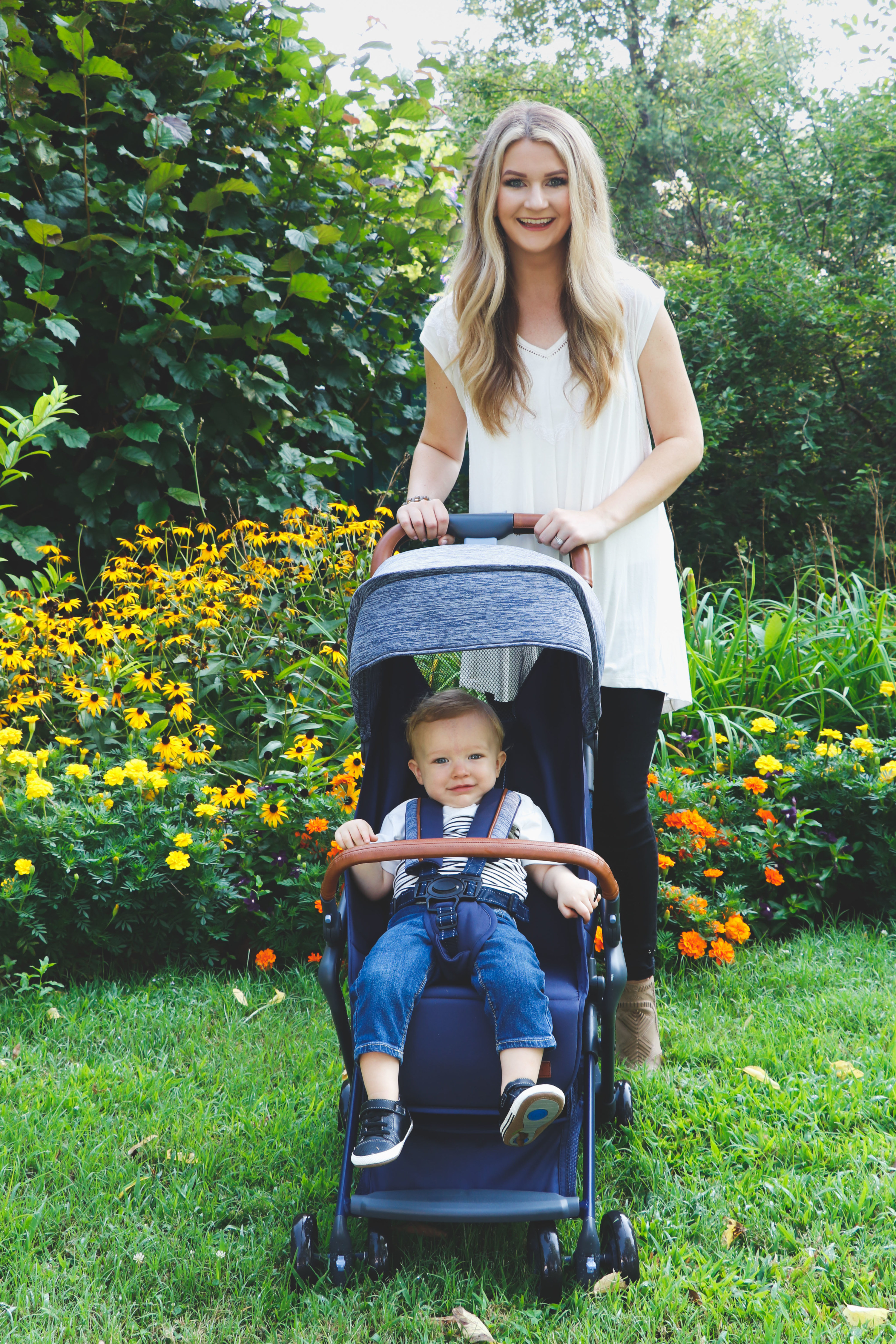 A model and baby using the stroller in a garden