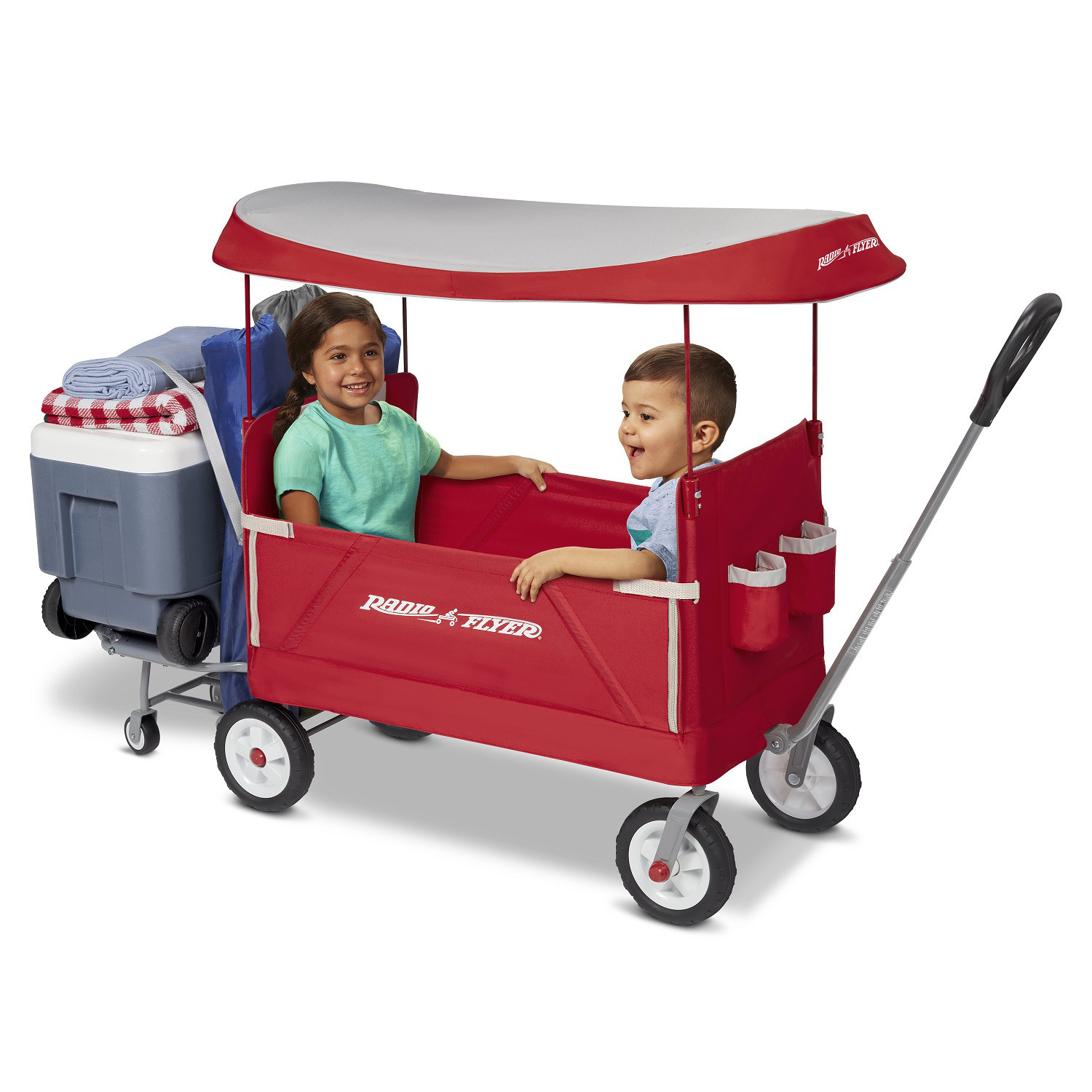 Two children in the red covered wagon