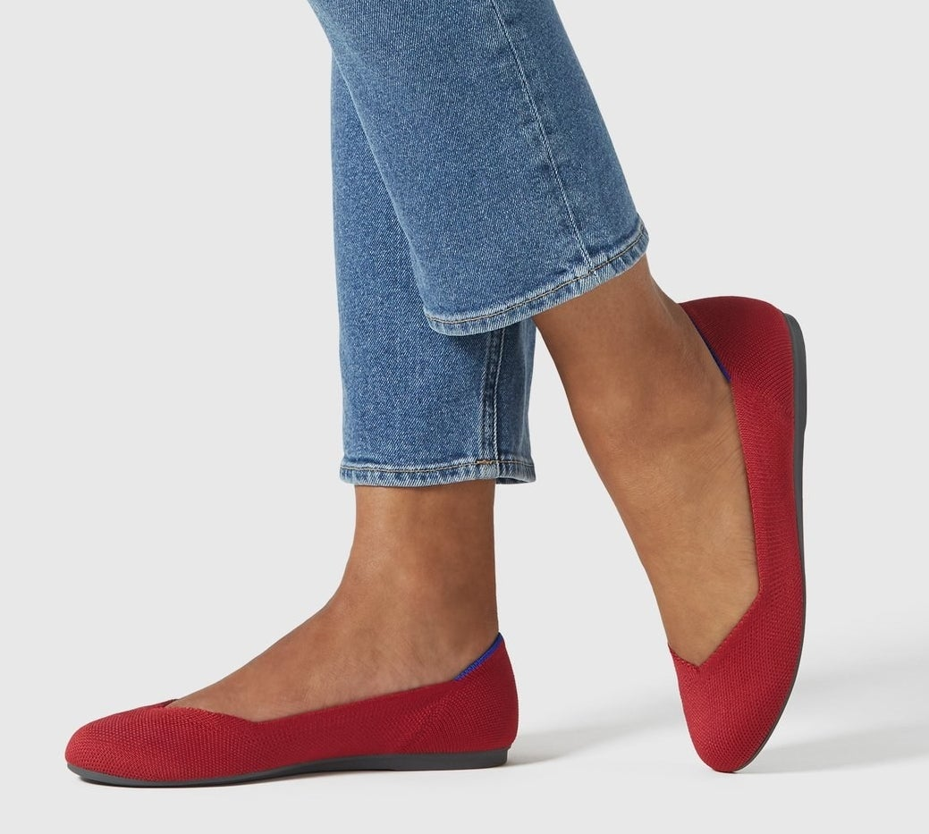 model in red fabric flats