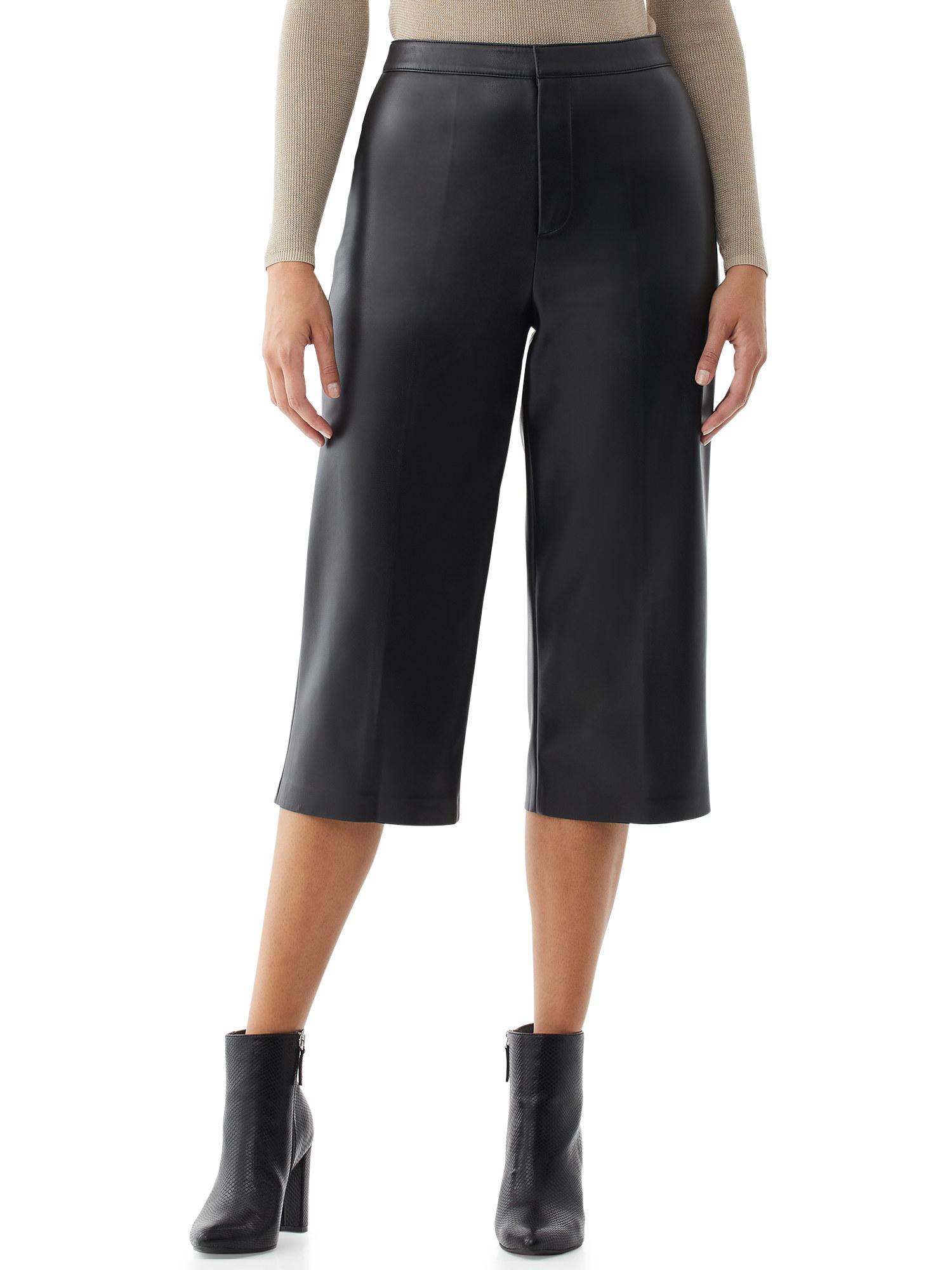 Model wearing faux leather pants