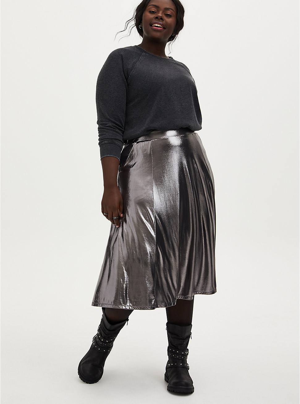 model wearing a silver metallic midi skirt