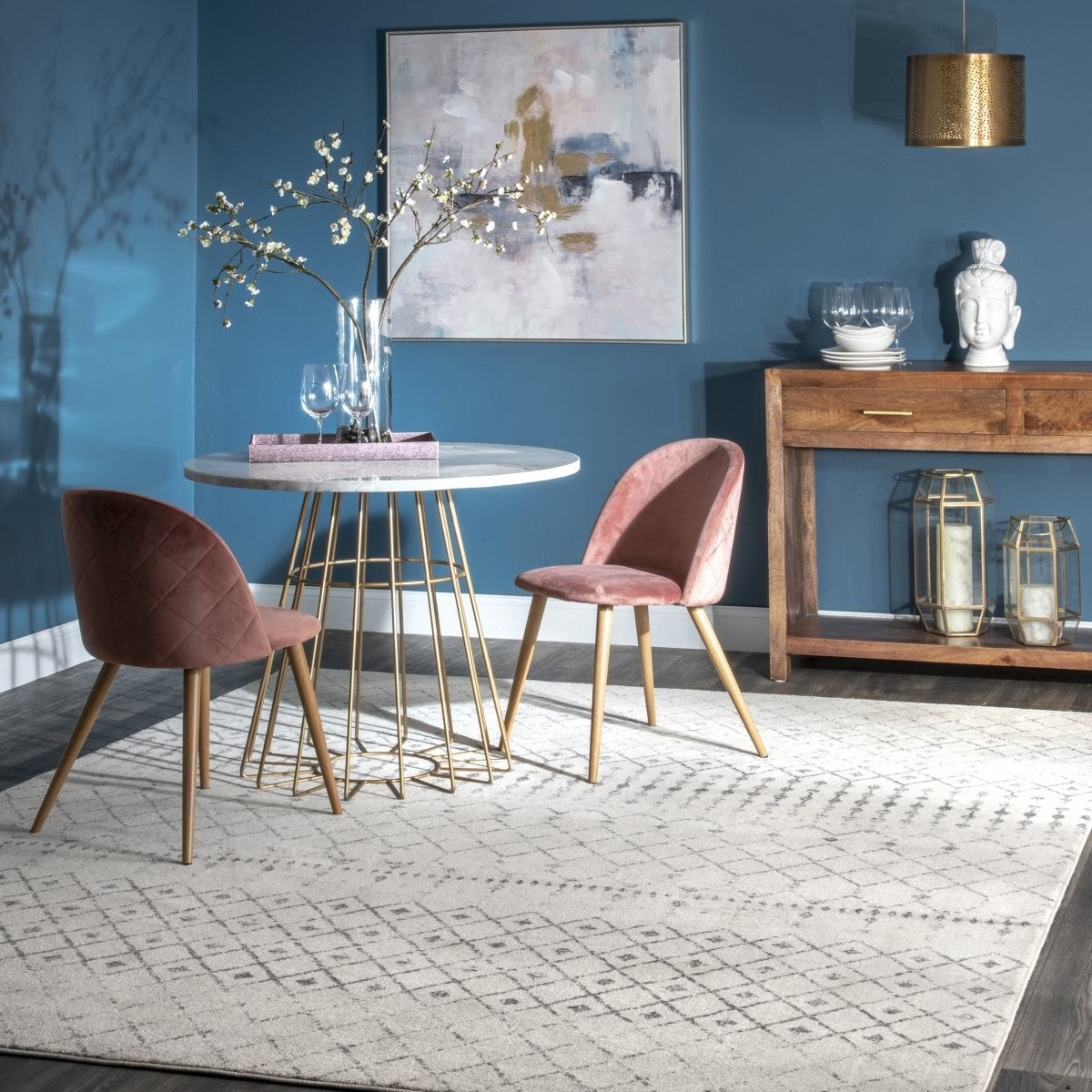 a white rug with a gray design throughout
