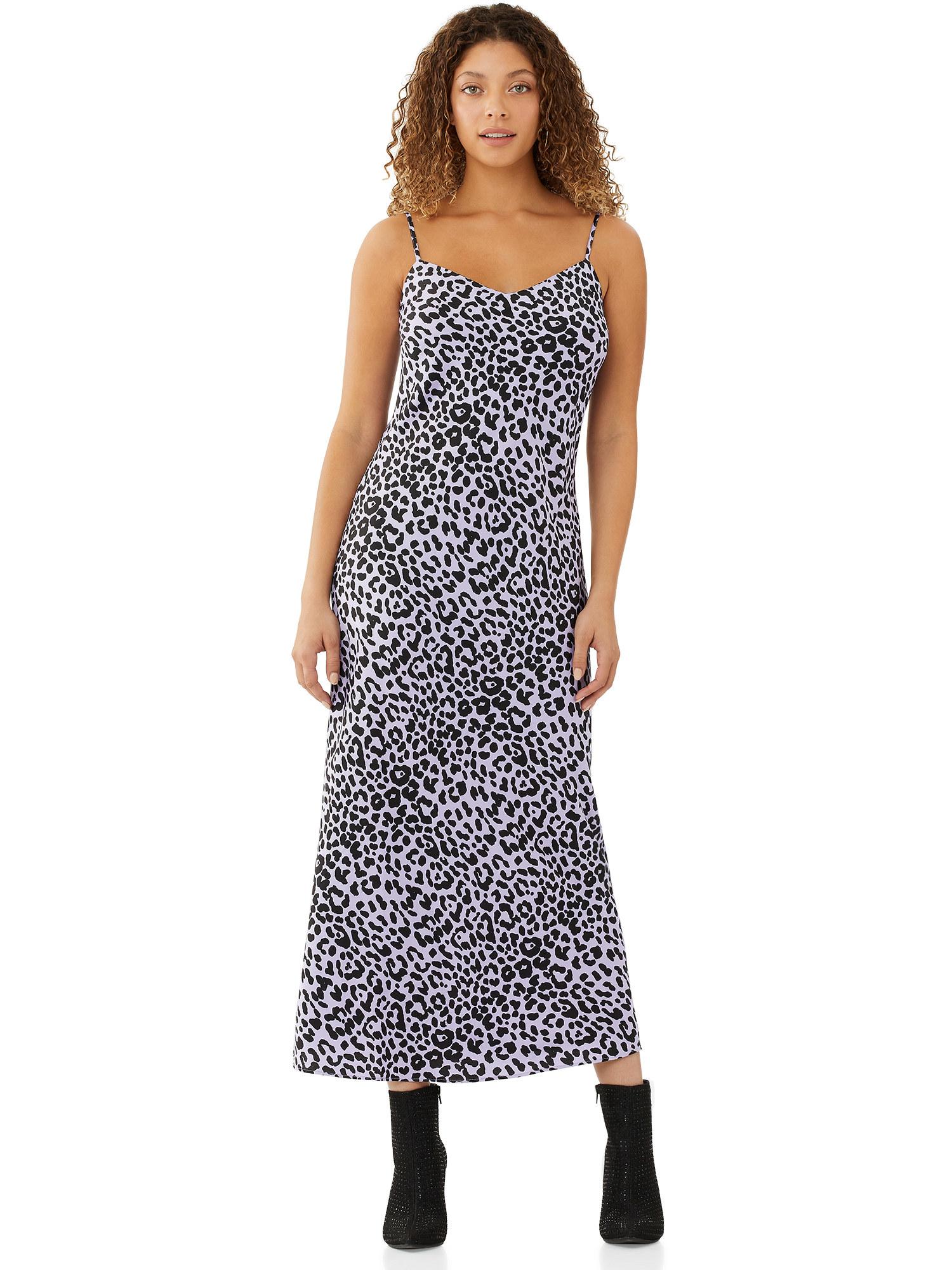 Model wearing purple animal print dress
