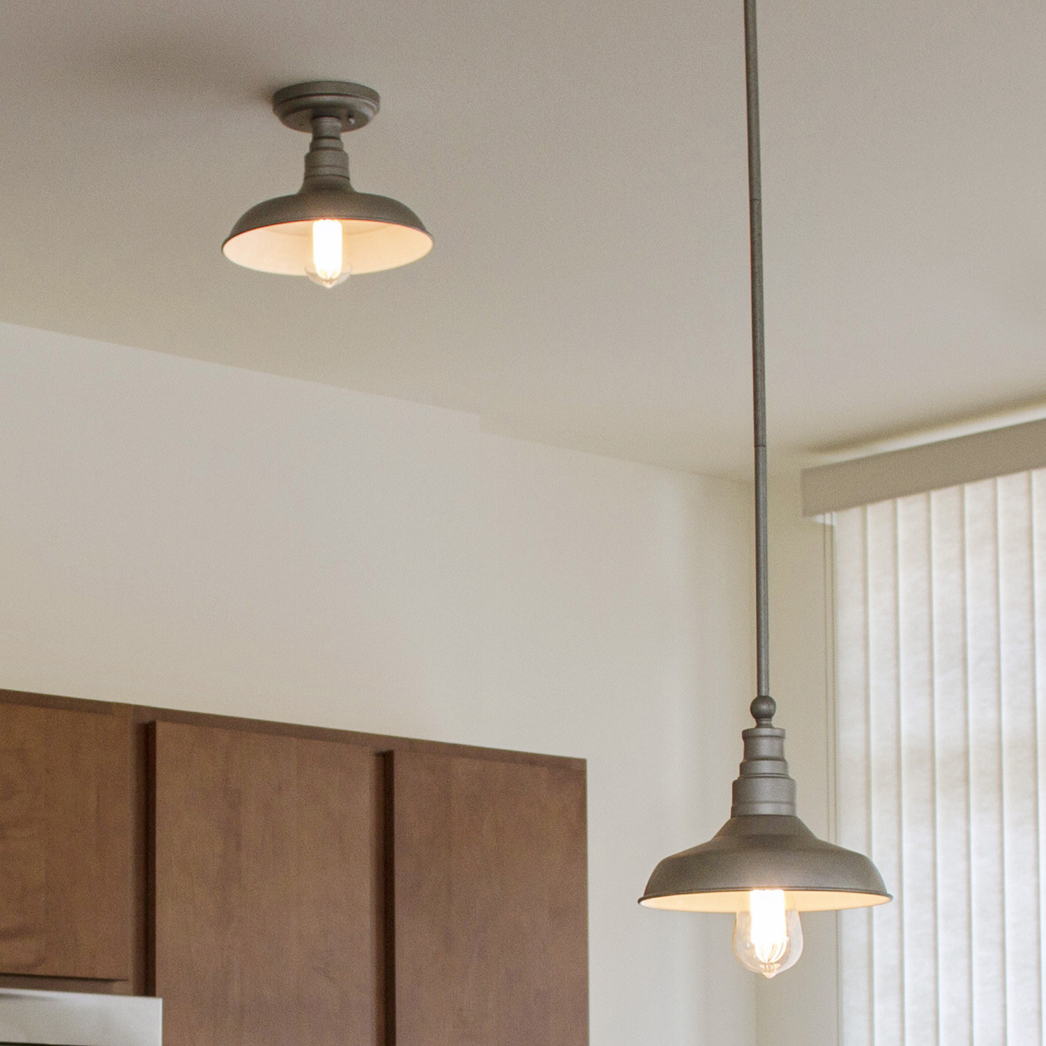 The tin light hanging at different lengths