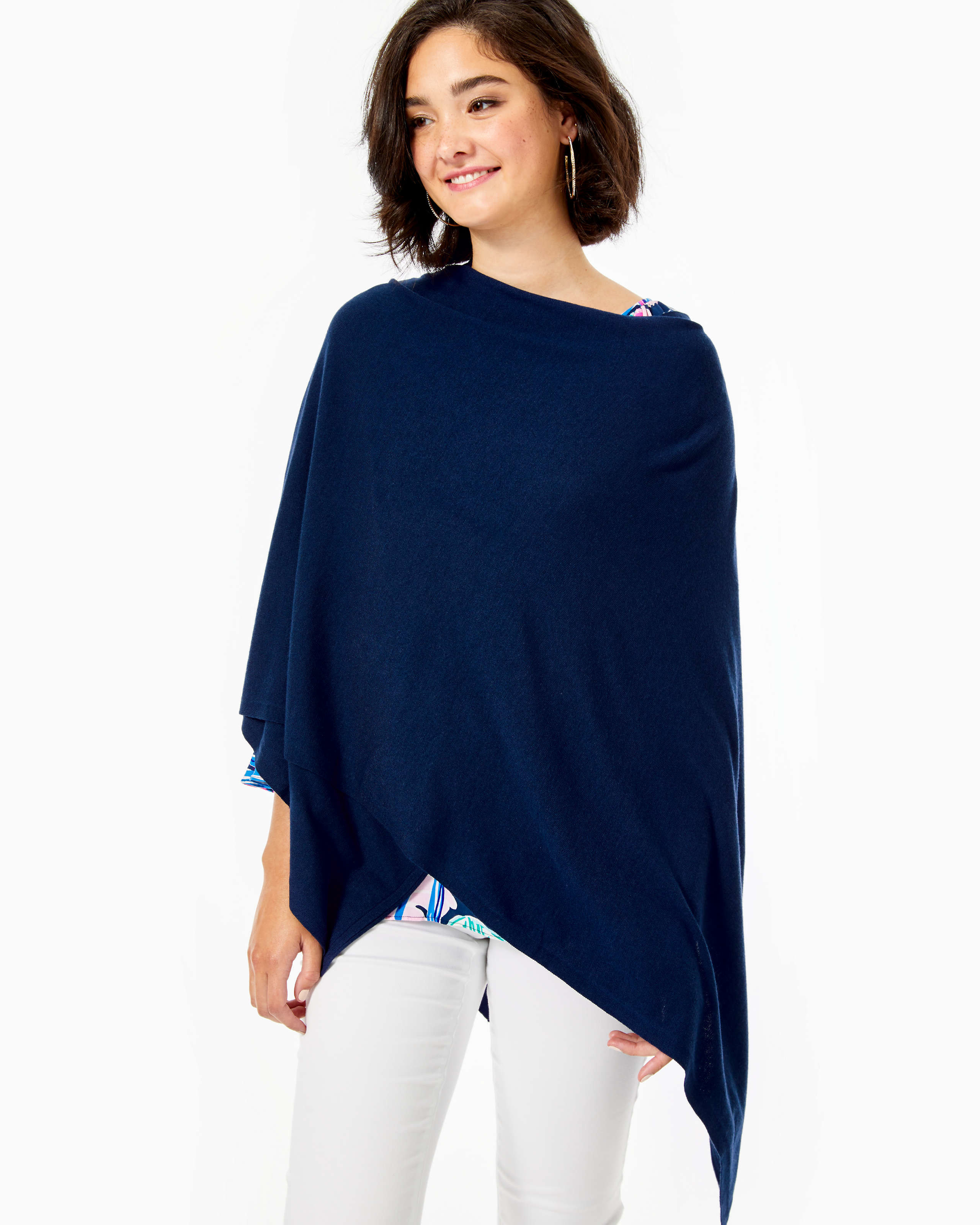 A model wrapped in navy shawl