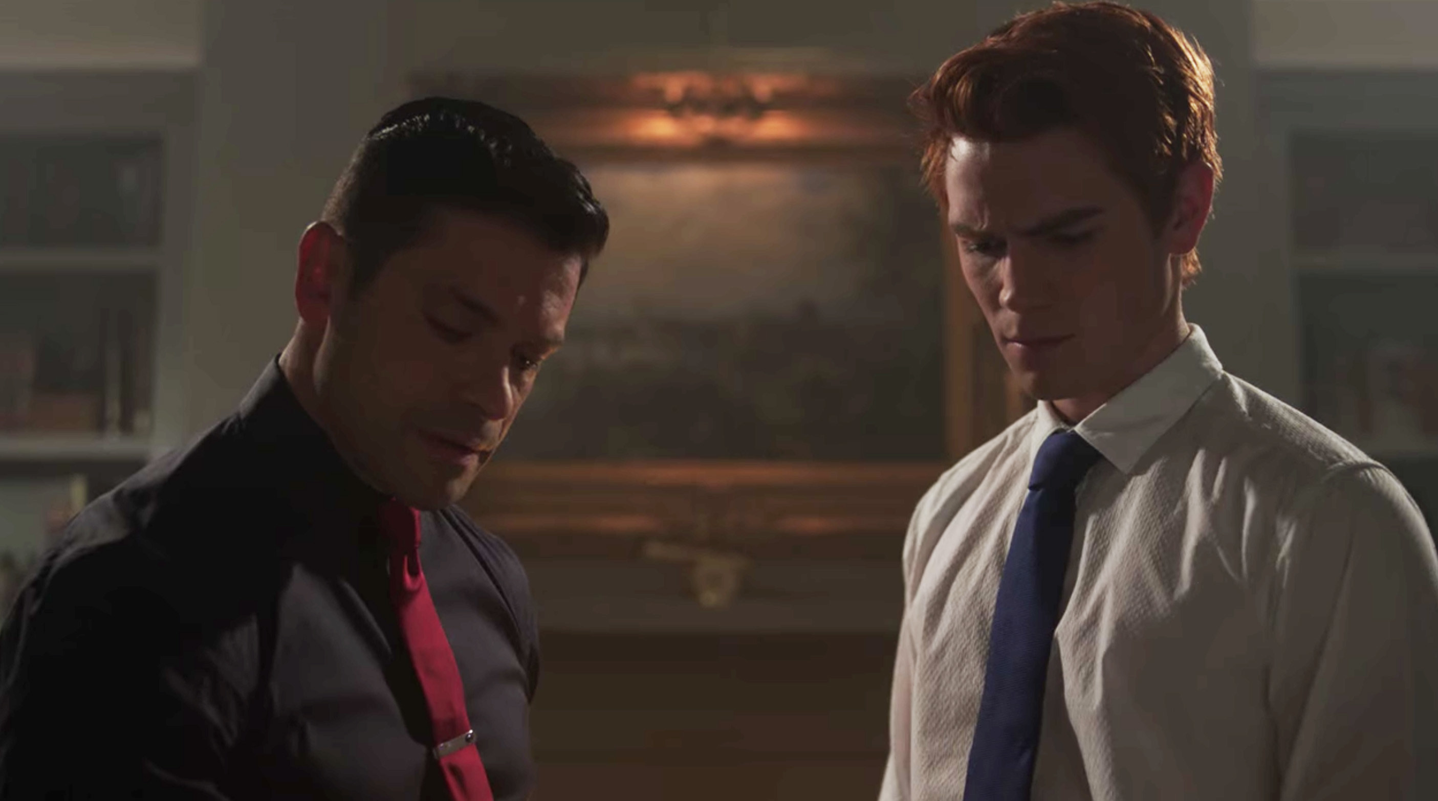 Archie and Hiram in Hiram's study