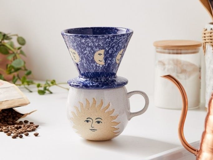 The celestial-themed set which comes with a blue pour over and white mug