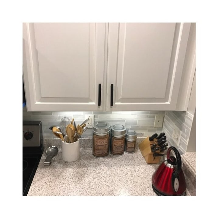Reviewer's cabinets with both the under-cabinet lights on and the main kitchen lights on
