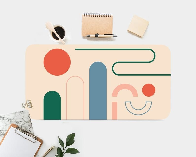 The desk mat which has an abstract geometric design