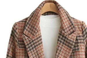 A close up the plaid coat
