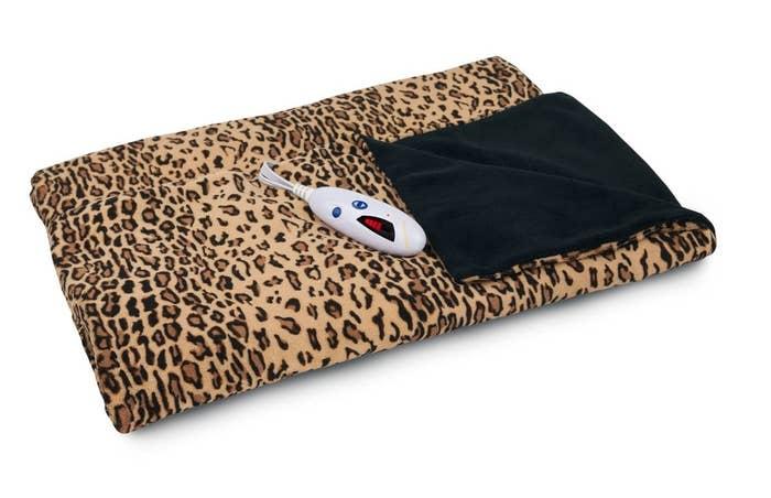 The blanket, shown in leopard print.