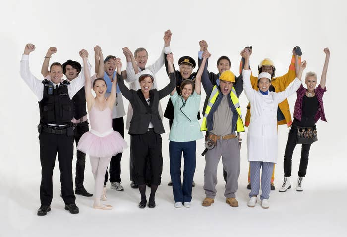 a group of people from variating backgrounds cheering