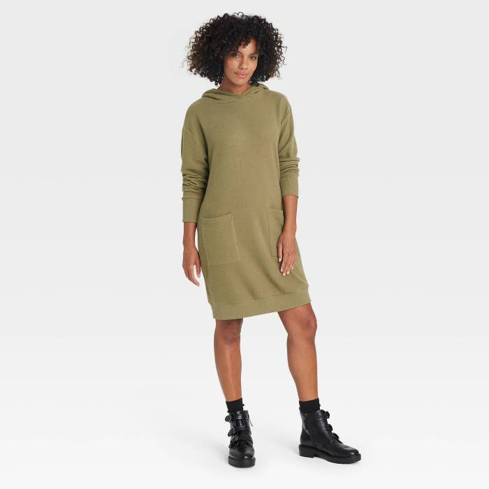 The model wearing the sweater dress