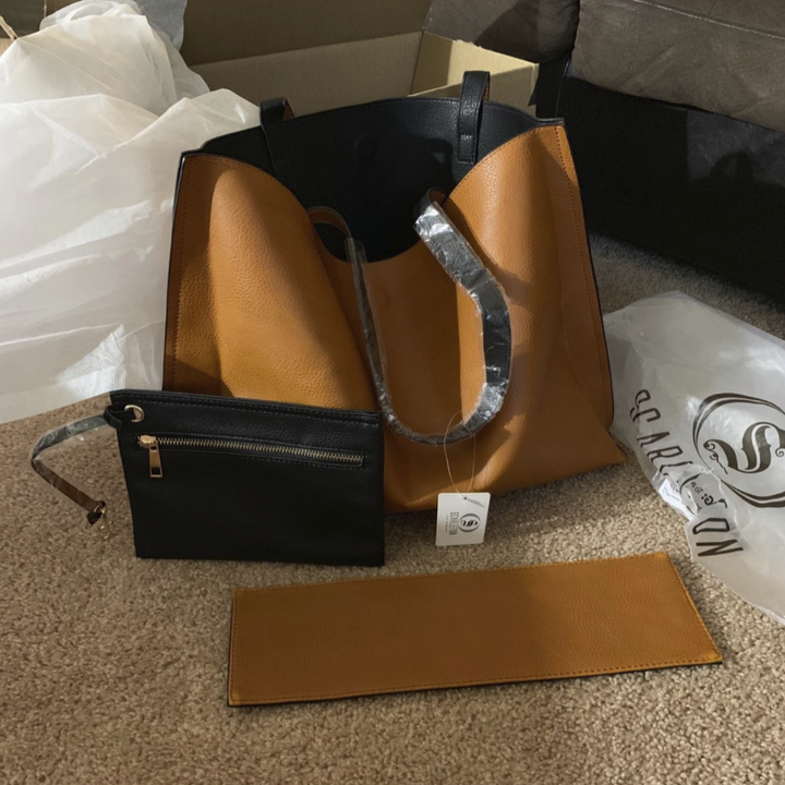 reviewer's black purse turned inside out to the tan side