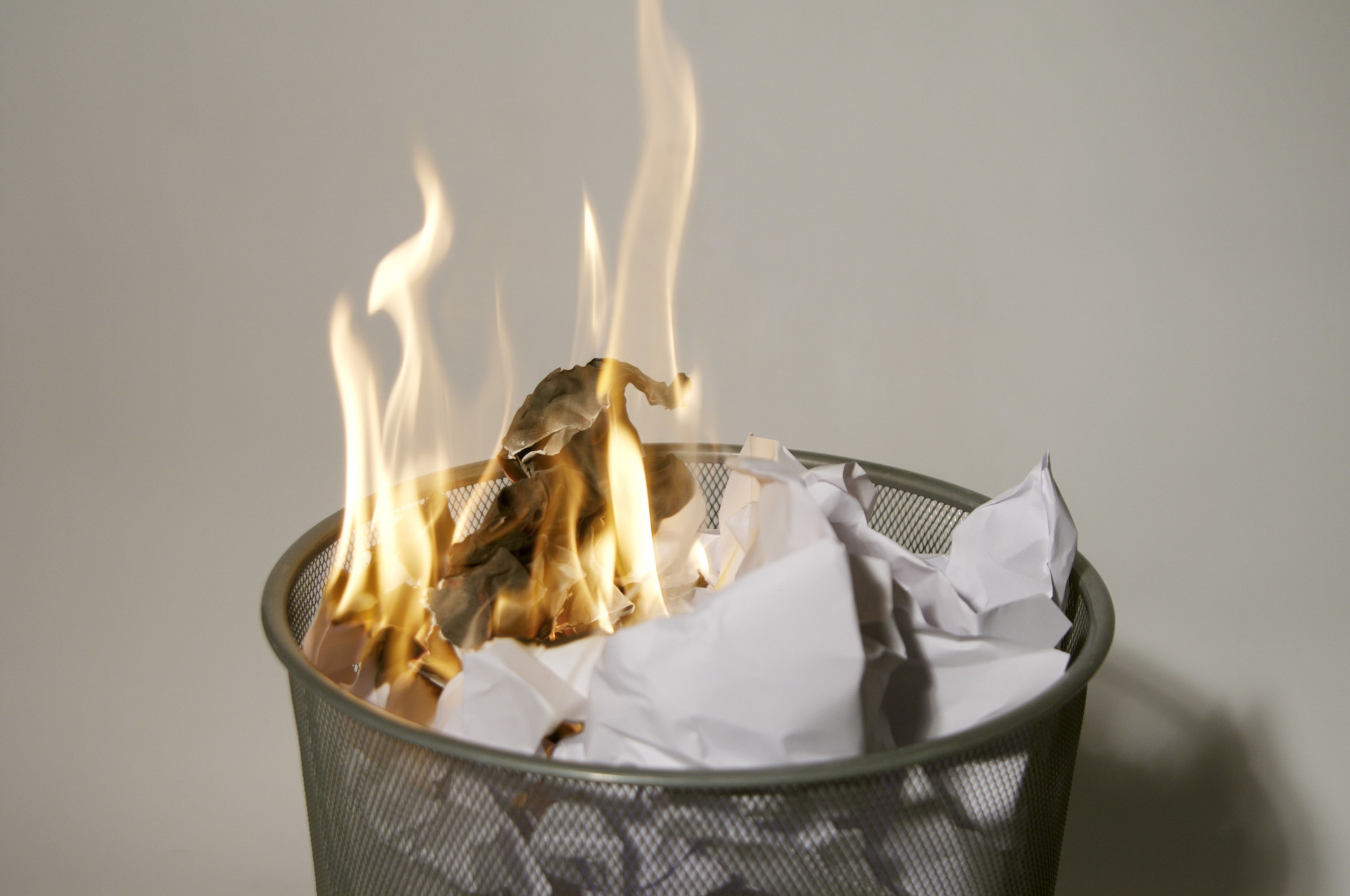 Paper burning inside of a trash can