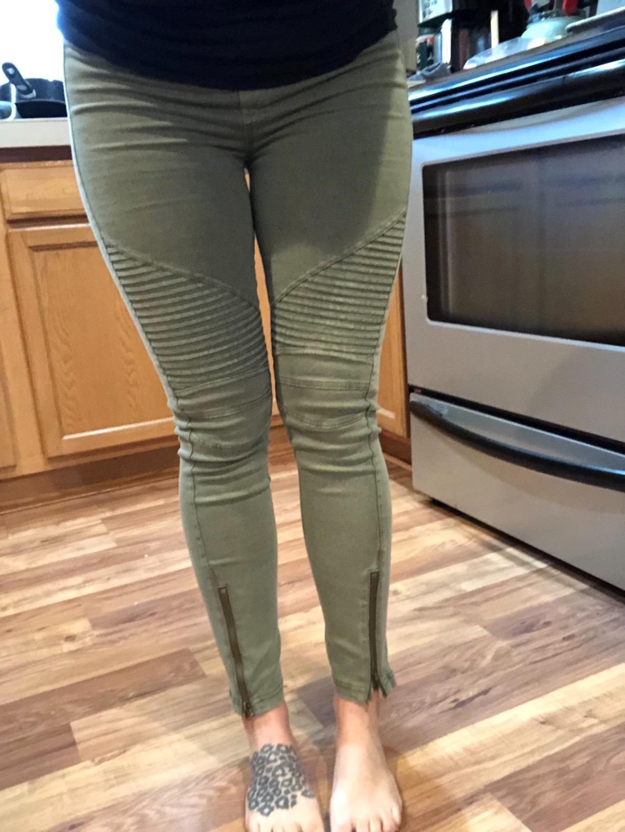 Reviewer wearing pleated biker pants