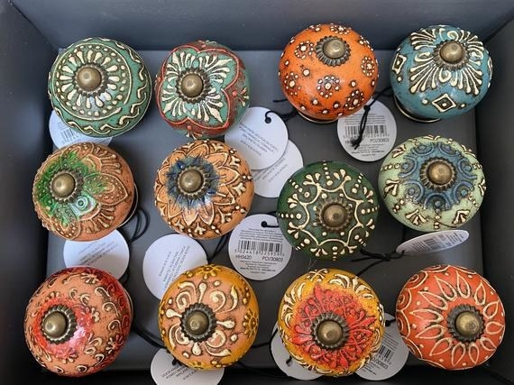 A variety of doorknobs in different colors