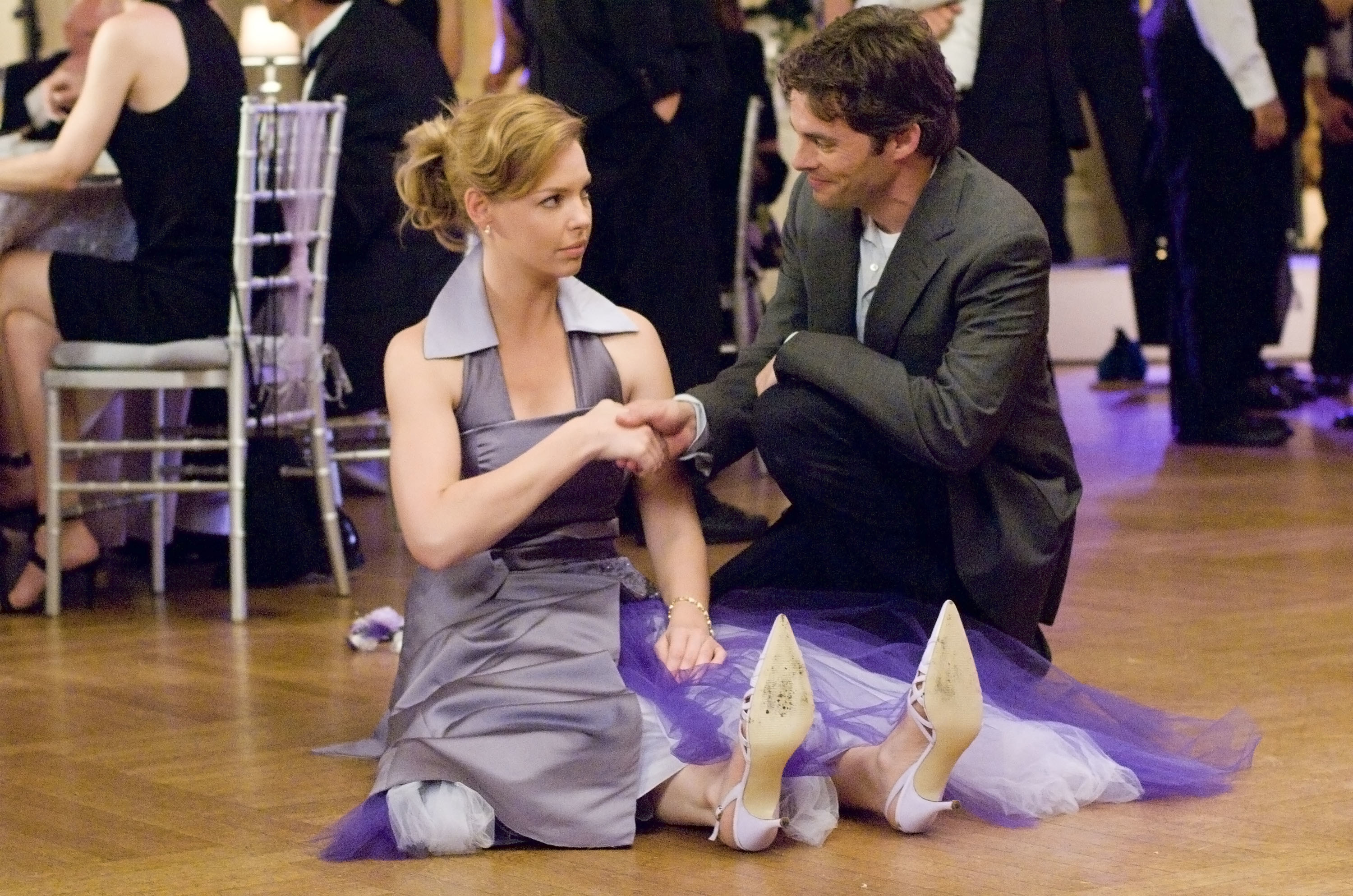 Kevin helping Jane up off of the floor