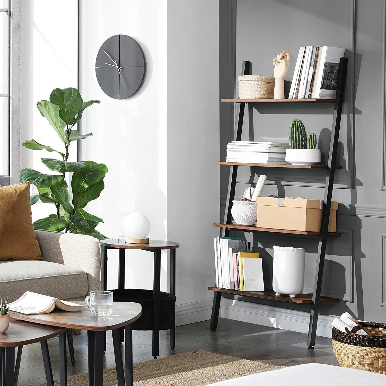 Angled metal frame with four wood shelves
