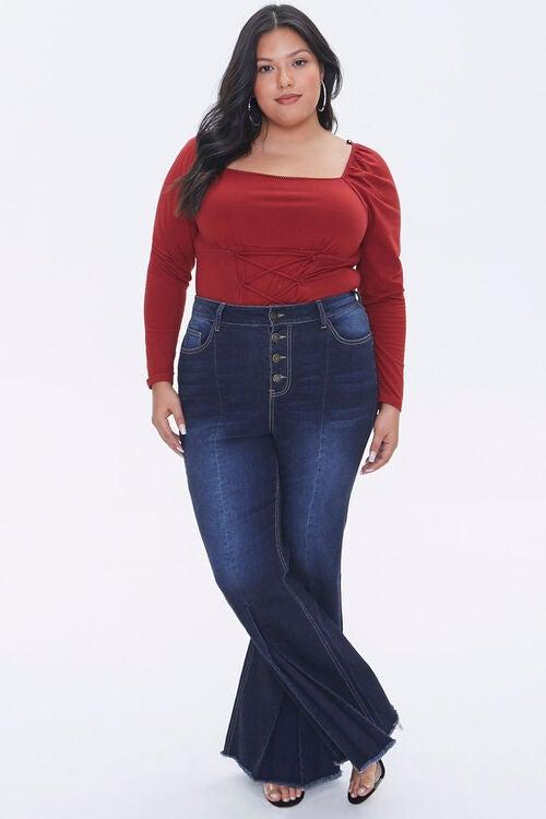 Model wearing flared denim jeans