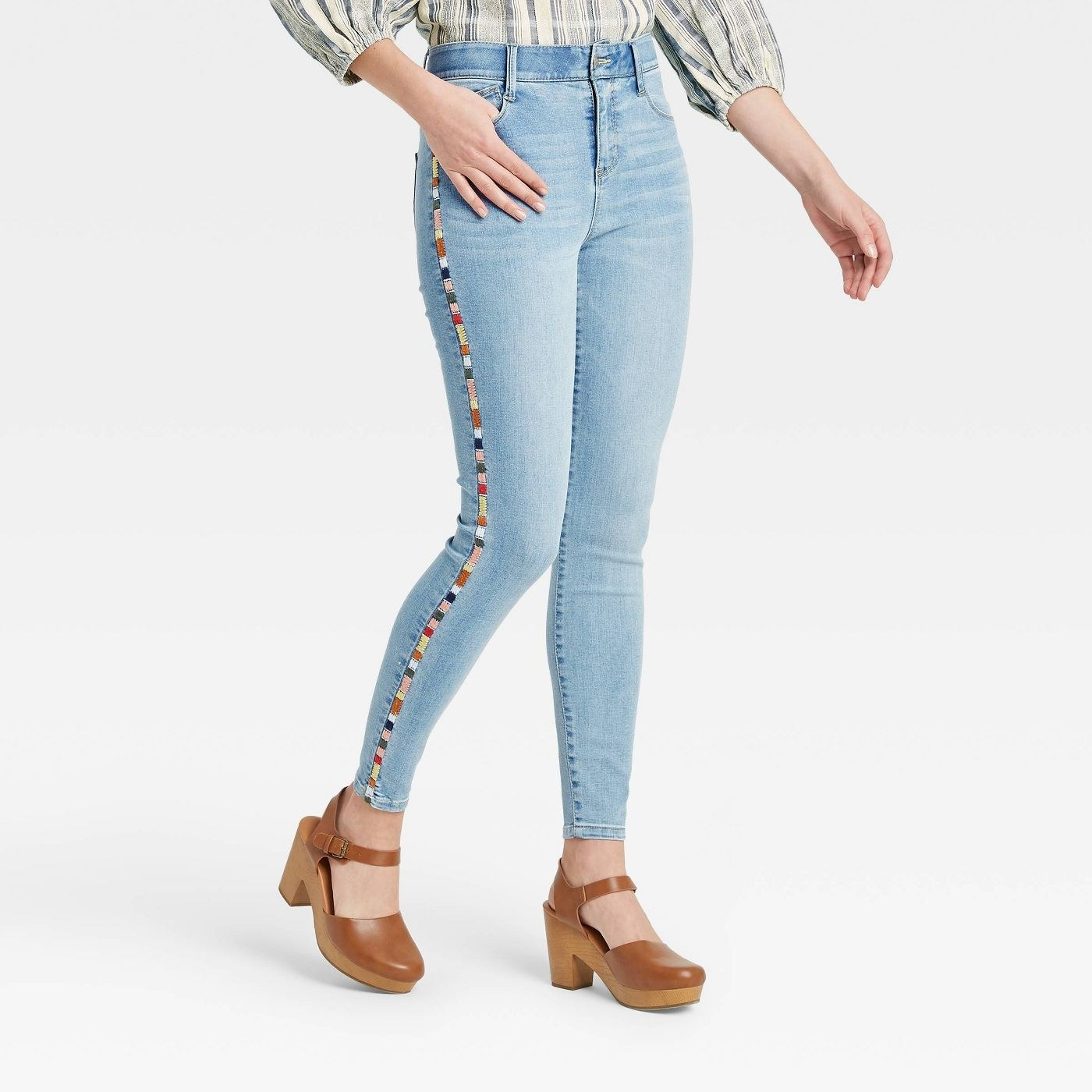 The jeans paired with brown clogs