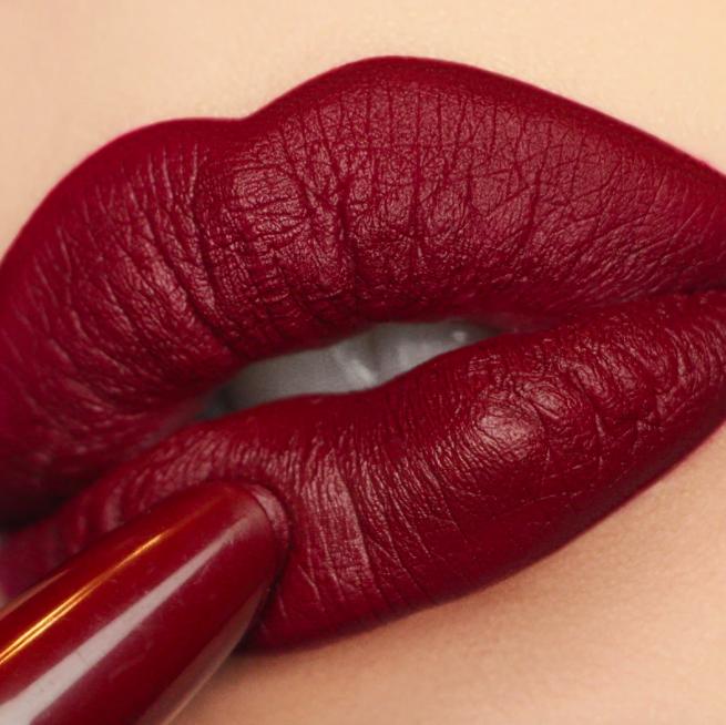 light skin tone model applying the lipstick