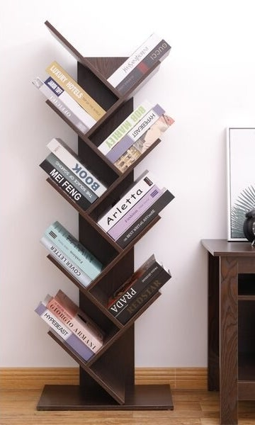 The bookshelf, which has 8 shelves that extend in a zig zag pattern, opening alternately to the left and the right