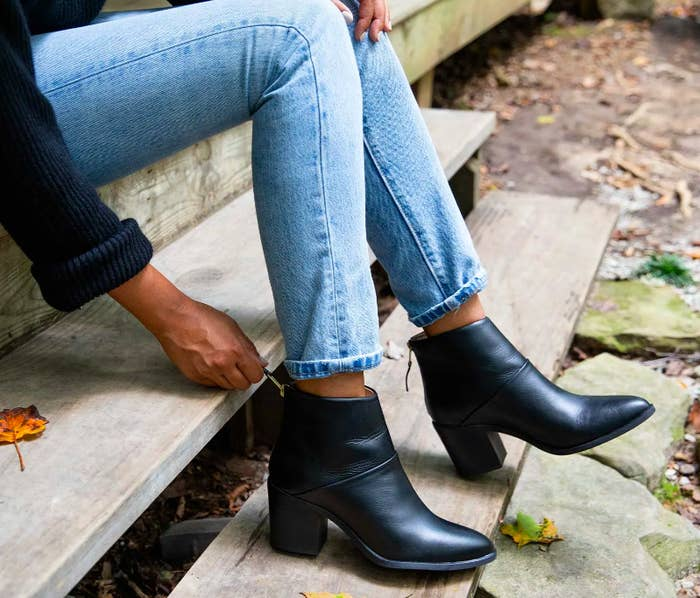 Black ankle-height boots with slight heel and zippers in back