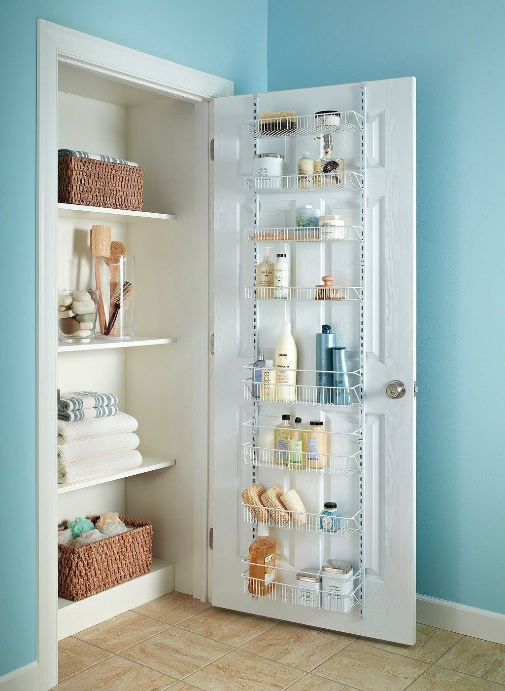eight-shelf wire rack on the back of a bathroom door, storing all sorts of soaps, sponges, and more