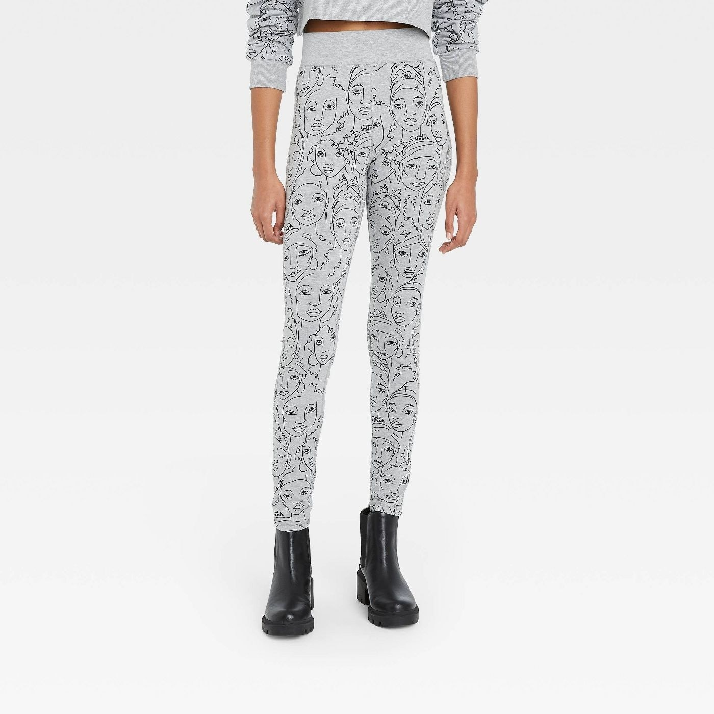 The sweatpants with illustrations of faces