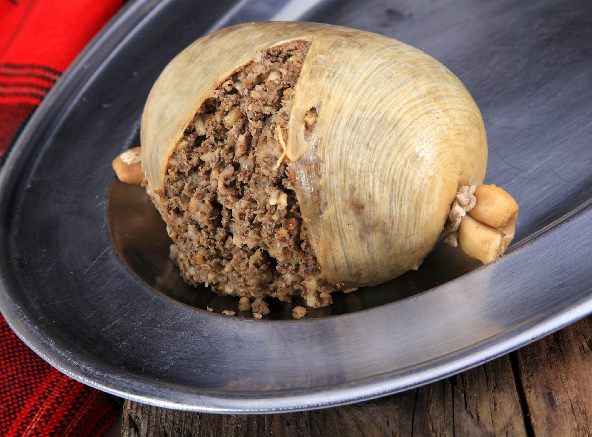 ground beef-like sausage spilling out of its casing
