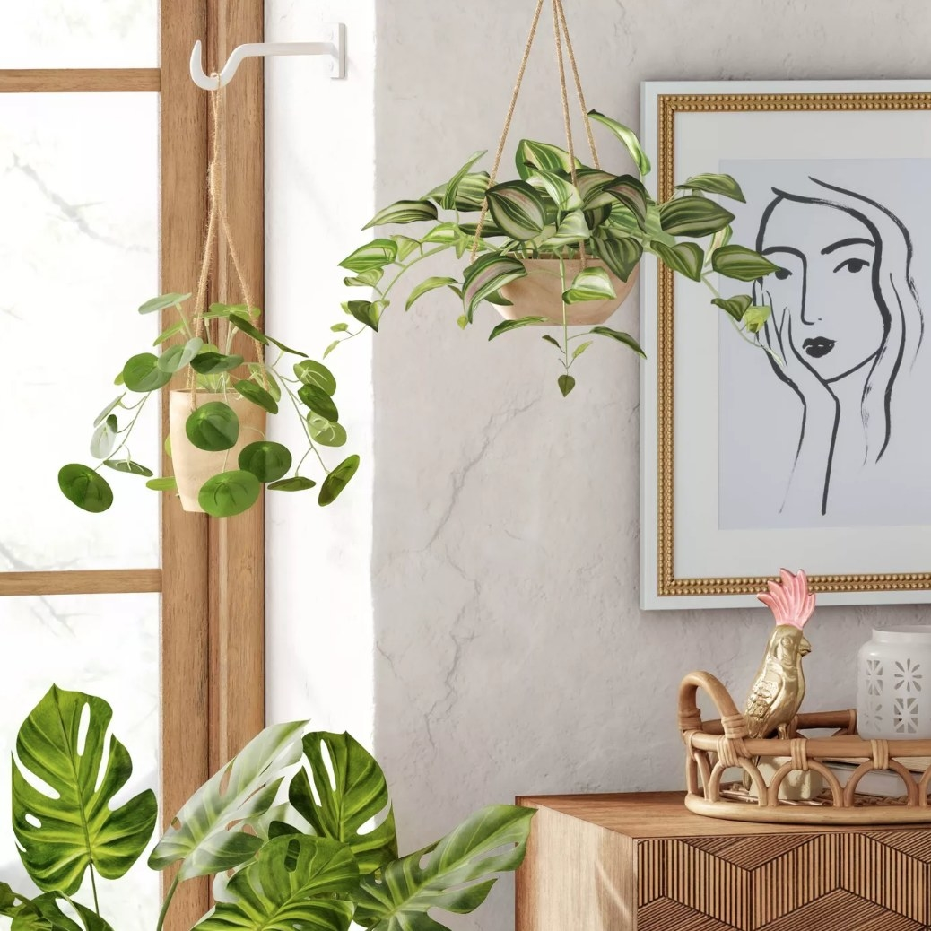Faux plants in wooden hanging planter