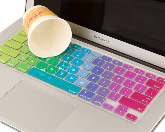 A rainbow keyboard cover with water spilled on it