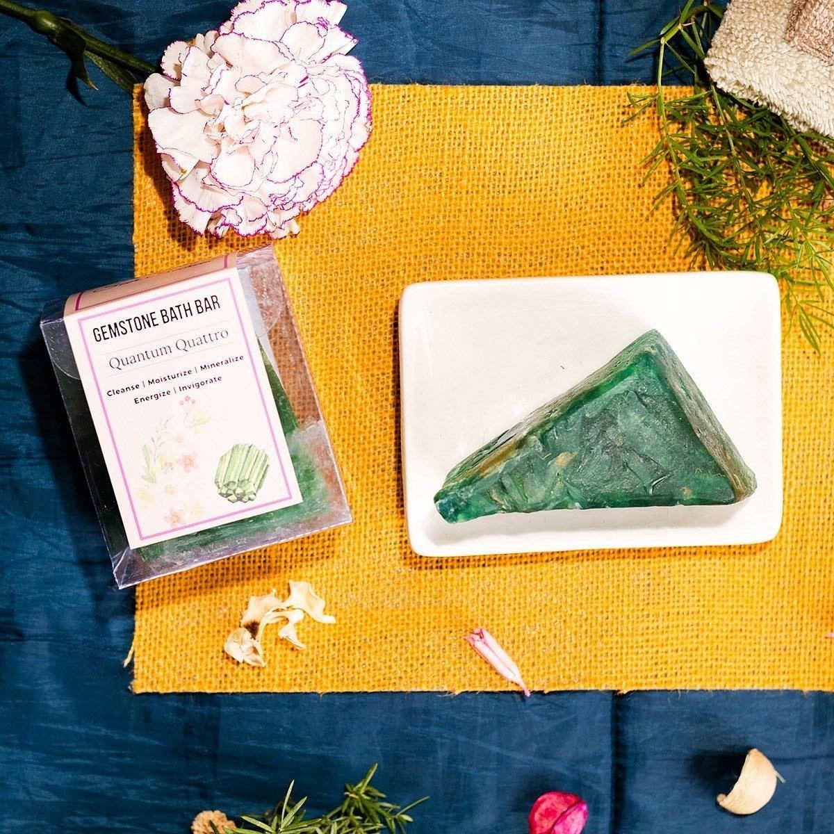 A gemstone soap bar next to a yellow cloth