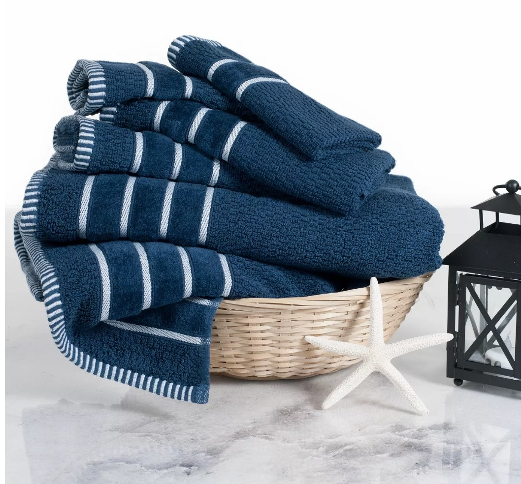 Blue towels with single white stripe in basket