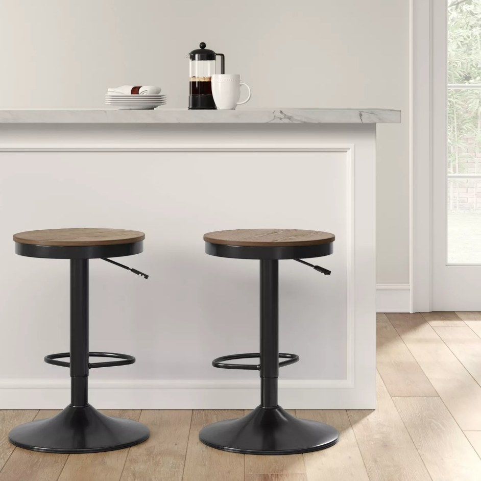 Two black barstools with walnut wooden seat
