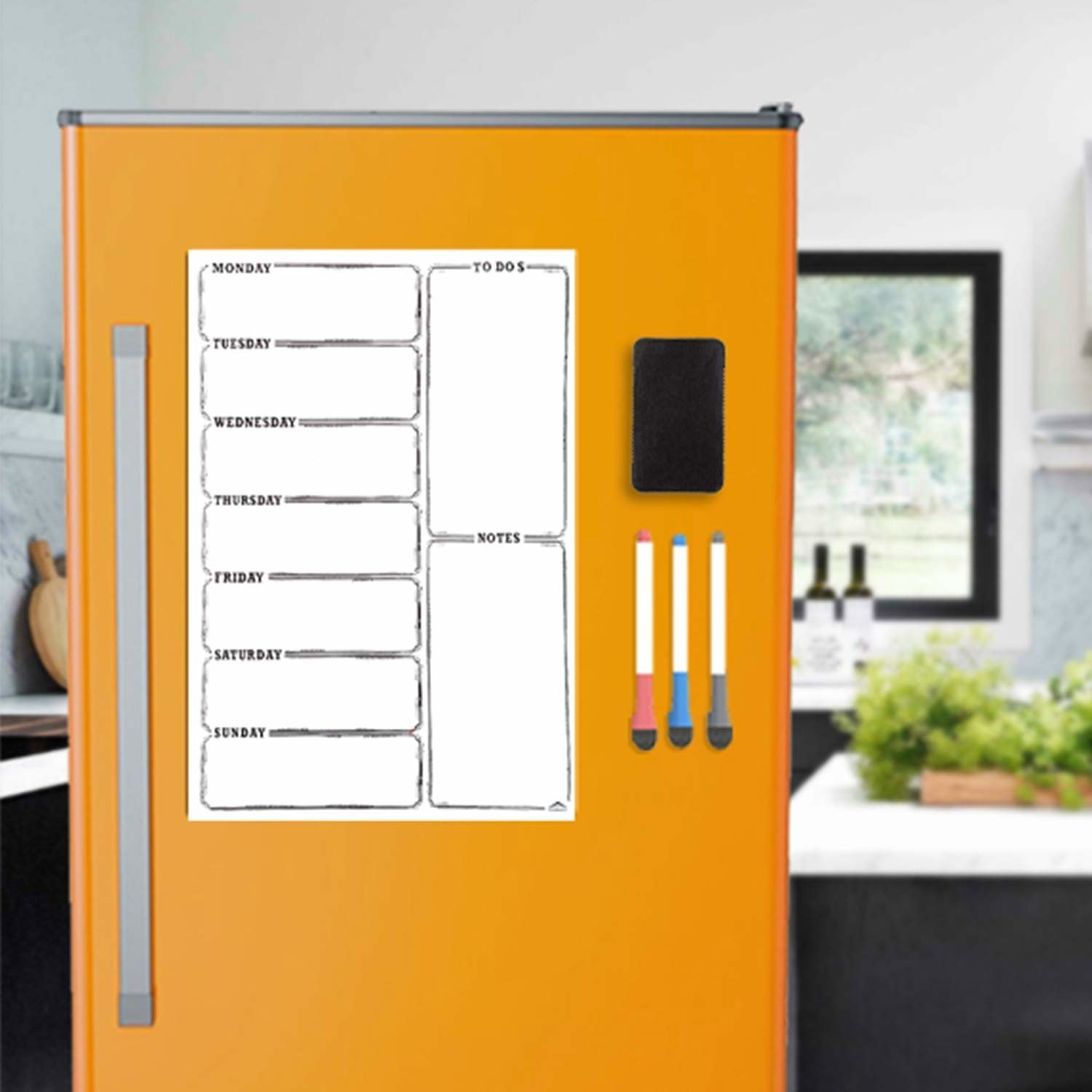 A dry erase planner on an orange wall